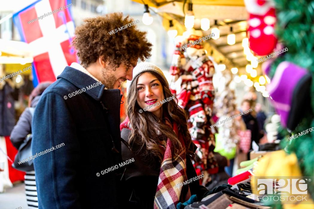 Stock Photo: Happy young couple at Christmas market.