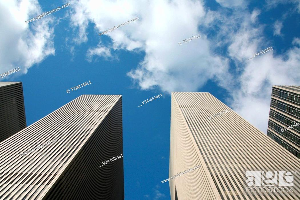 Stock Photo: Corporate buildings piercing the sky.