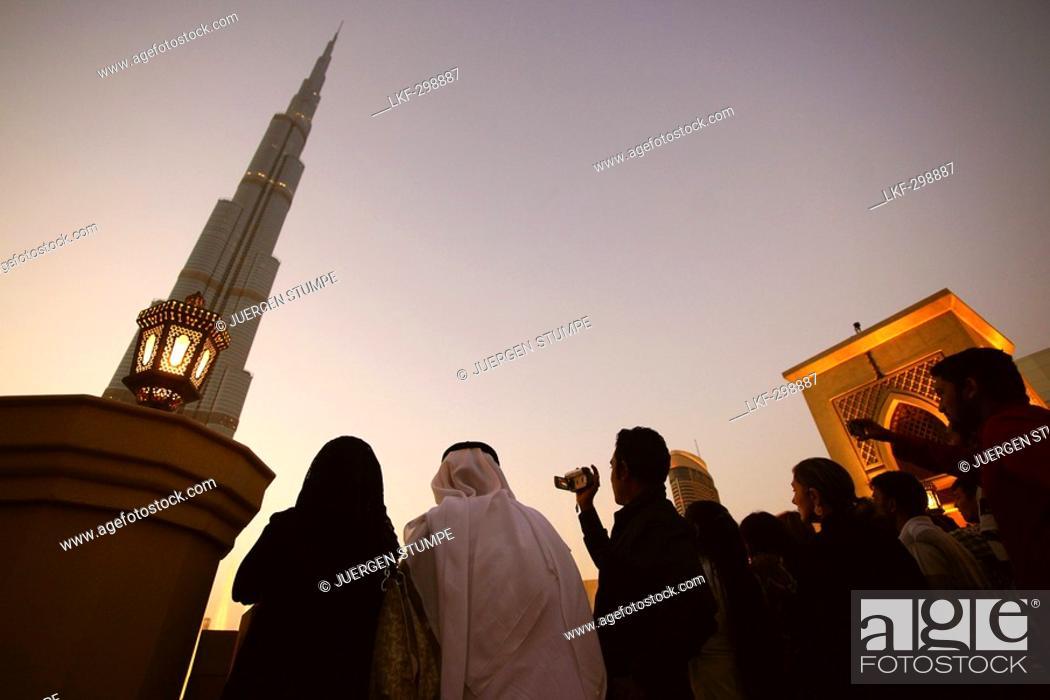 Stock Photo: People in front of the Burj Khalifa in the evening, Burj Chalifa, Dubai, UAE, United Arab Emirates, Middle East, Asia.