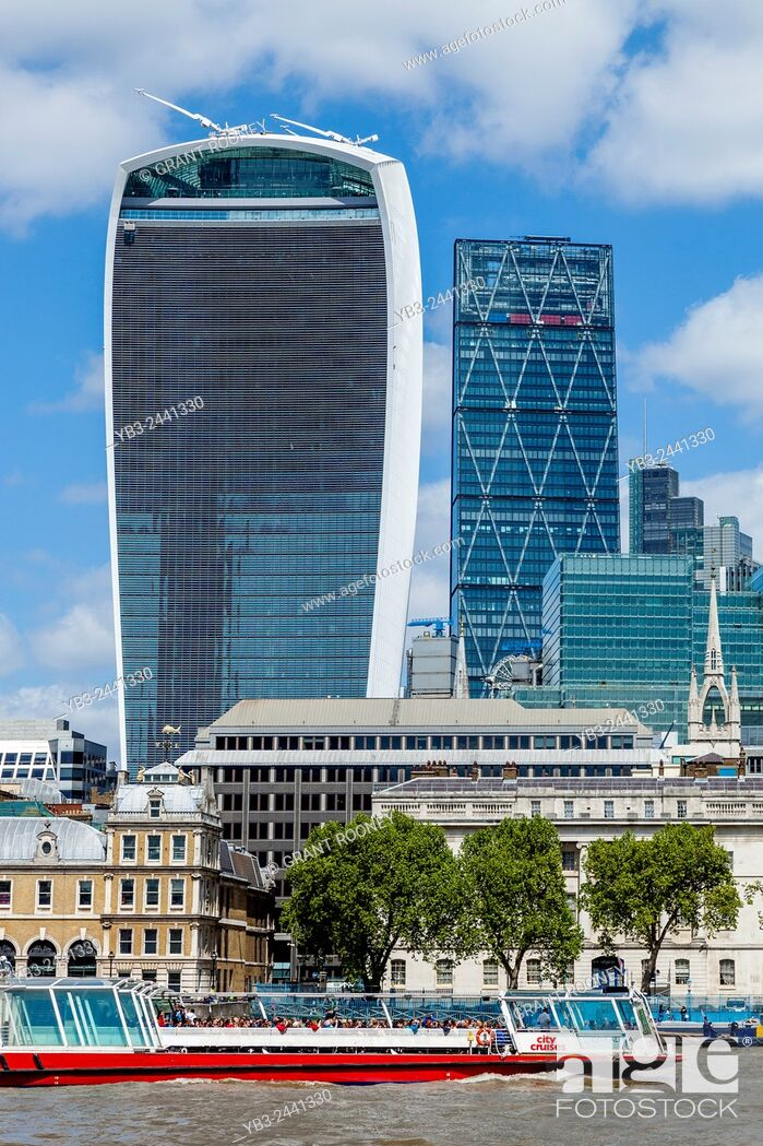 Stock Photo: A City Tours River Cruiser and City of London Skyline, London, England.