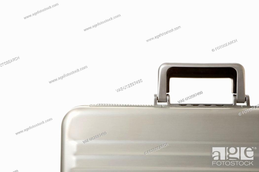 Stock Photo: Detail of handle on silver briefcase.
