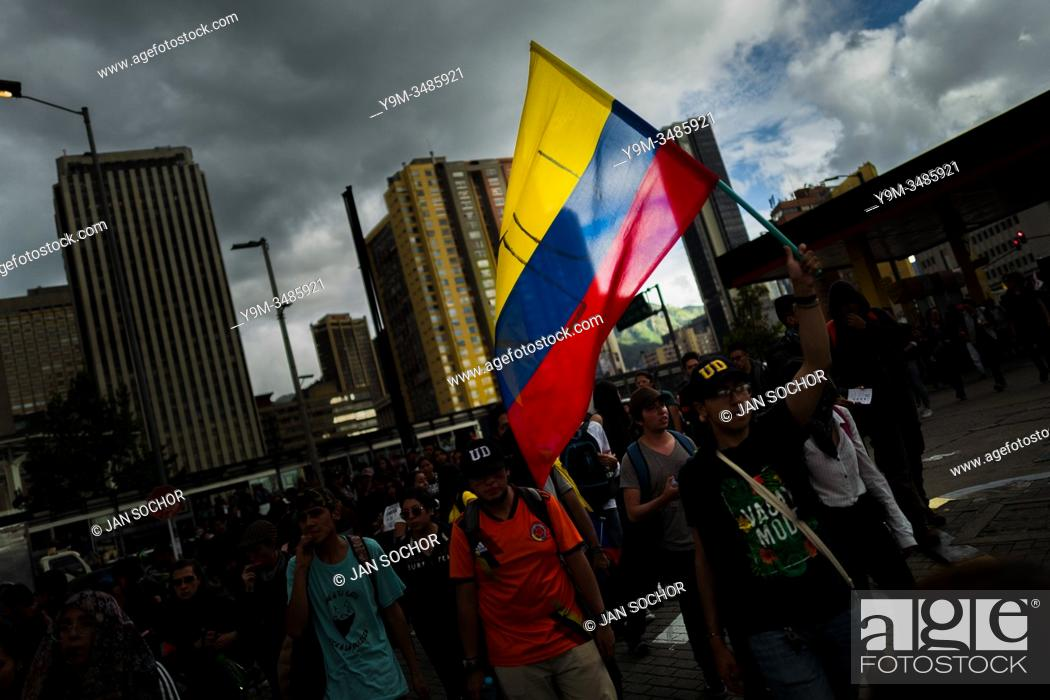 Stock Photo: Students of the Universidad Nacional de Colombia, carrying the Colombian flag, take part in a protest march against government's policies and corruption within.