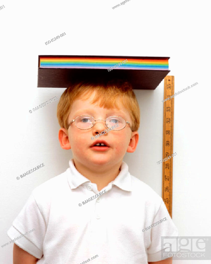 Stock Photo: Measuring height of young boy.