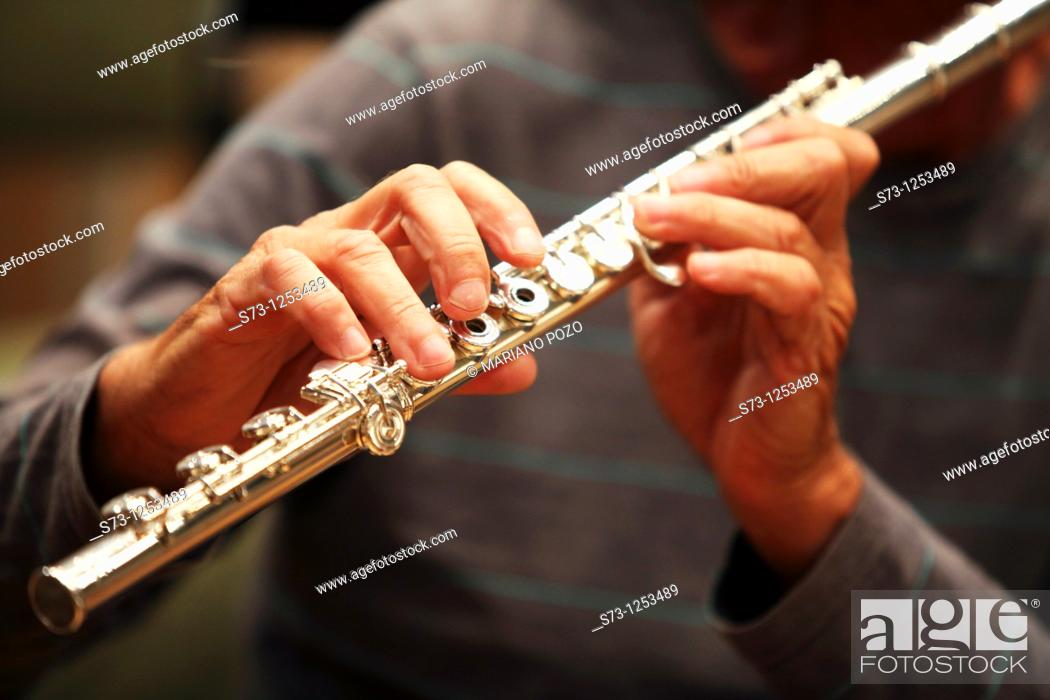 Stock Photo: Man playing flute.