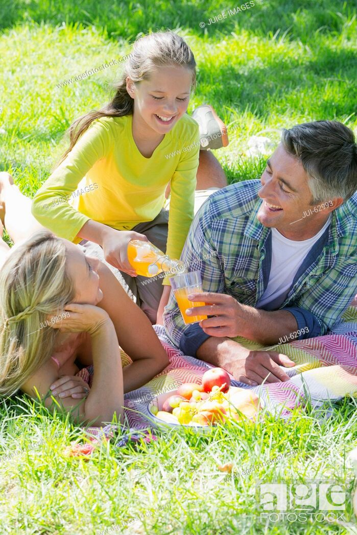 Stock Photo: Family having a picnic in countryside.