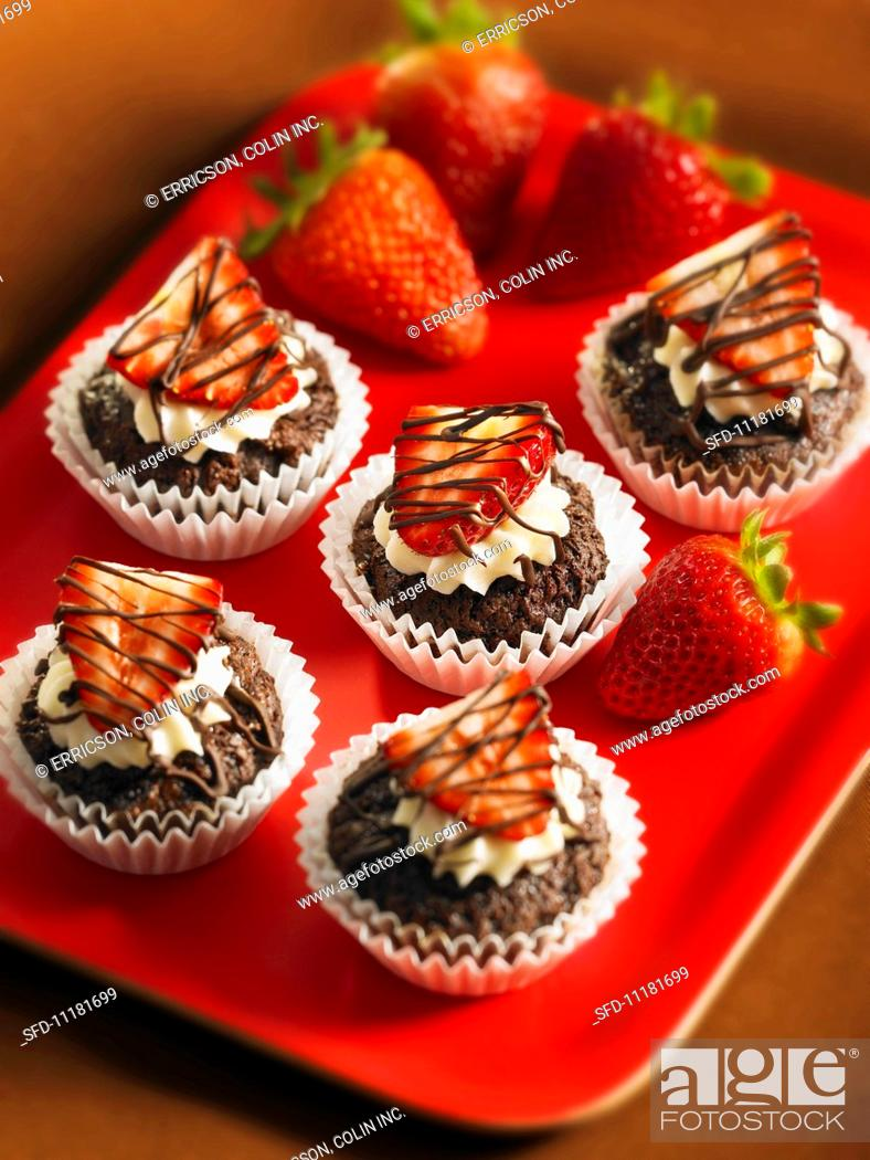 Stock Photo: Individual brownie cakes with strawberries.