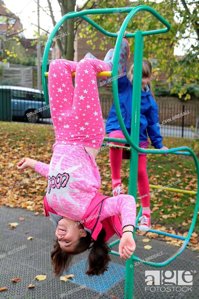 Stock Photo: Girls playing in urban park.