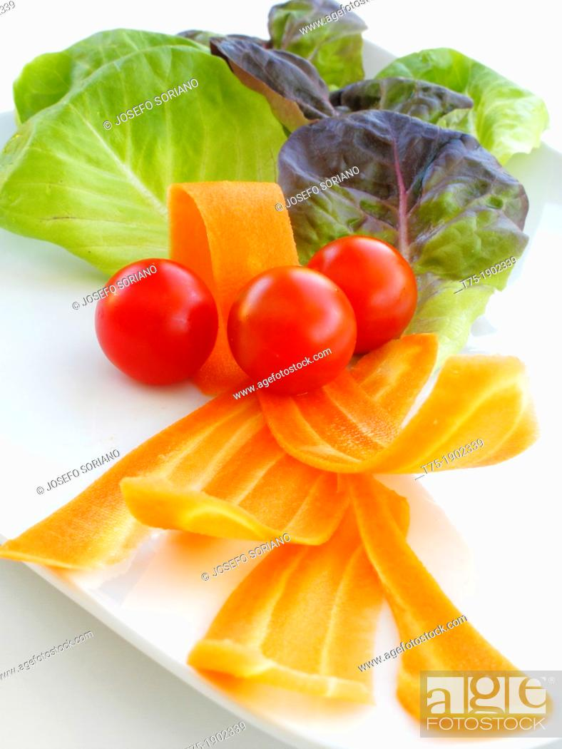 Stock Photo: Salad with tomatoes and carrots.