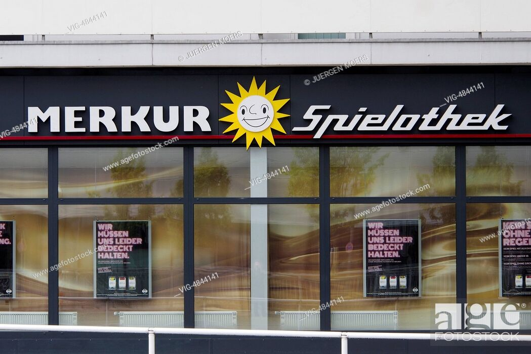 Stock Photo: 06.05.2014, Germany, Essen, MERKUR Spielothek sign on buildings. - Essen, Germany, 06/05/2014.