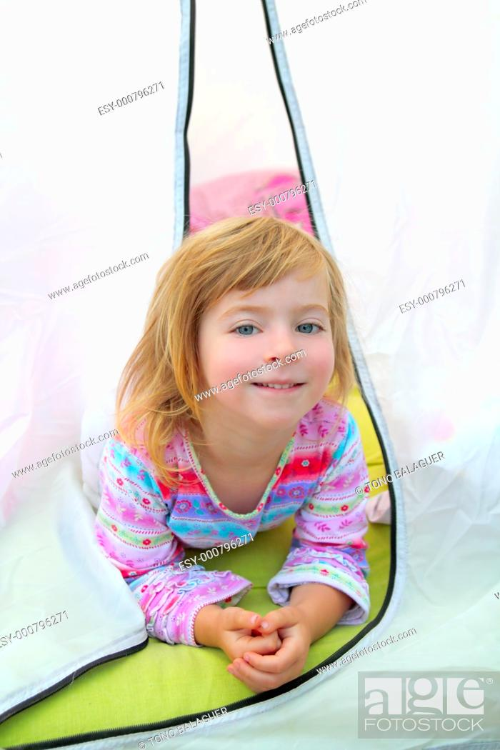 Stock Photo: girl in camping tent lying happy on camp tent.
