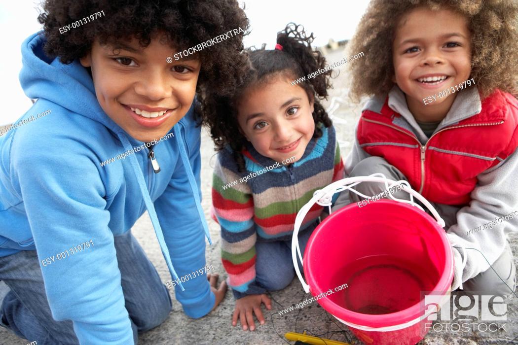 Stock Photo: Children fishing for crabs.