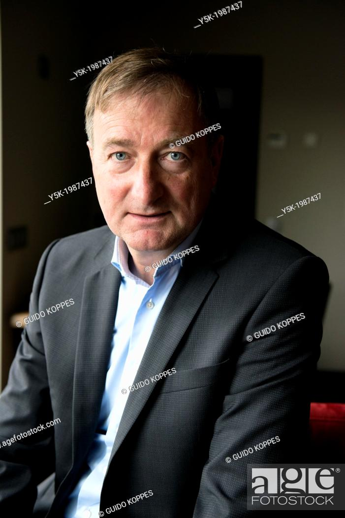 Stock Photo: Zundert, Netherlands. Author of pocketbooks, portrayed in his living room.