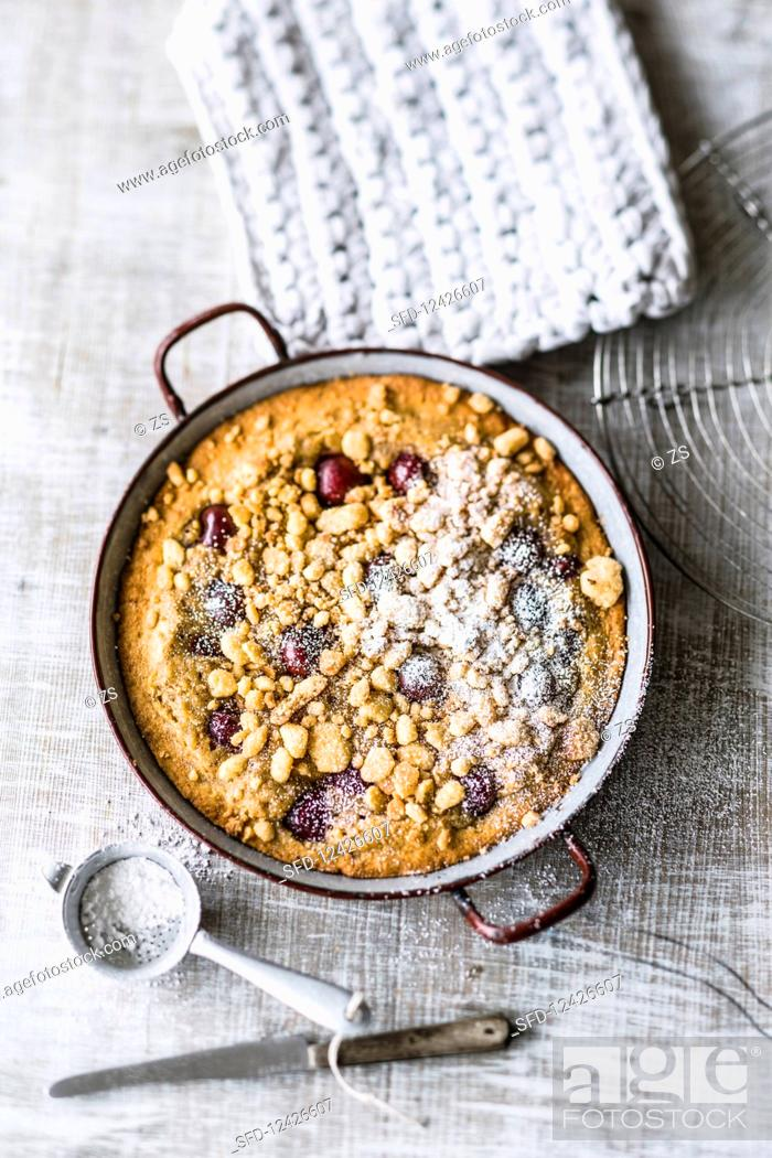 Photo de stock: Pan-baked cherry crumble cake with hazelnuts.