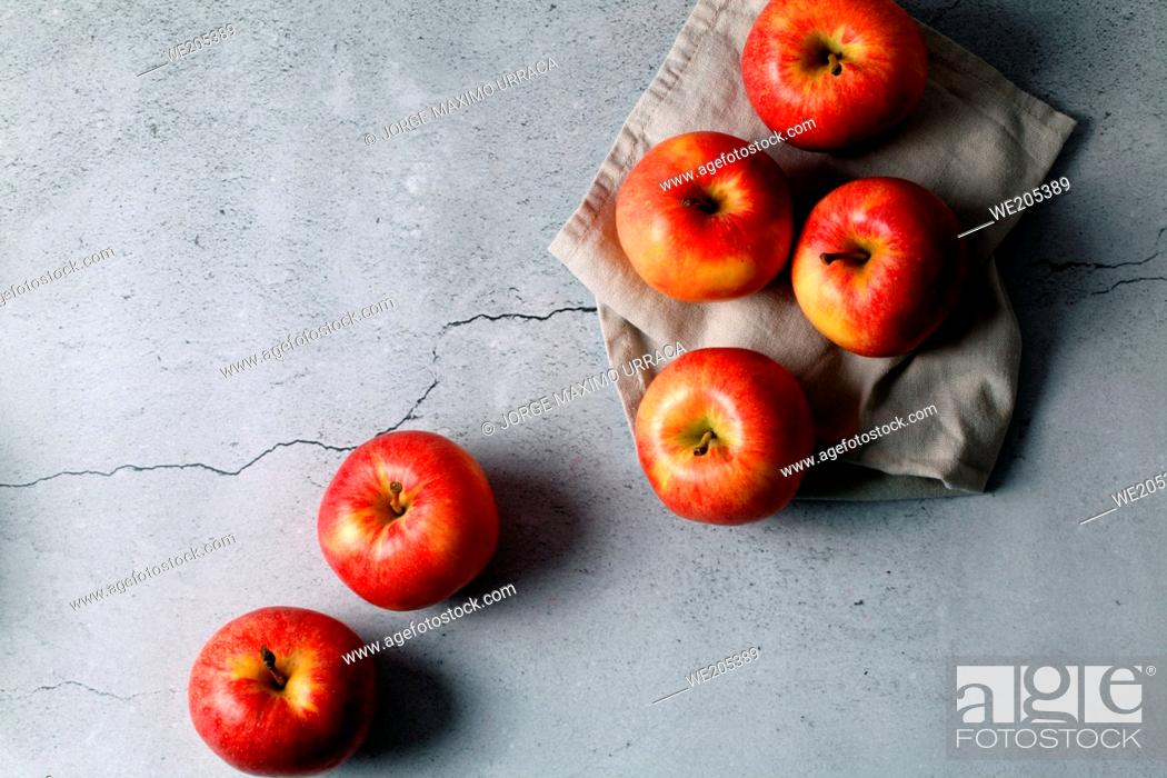 Stock Photo: Red apples on stone background.