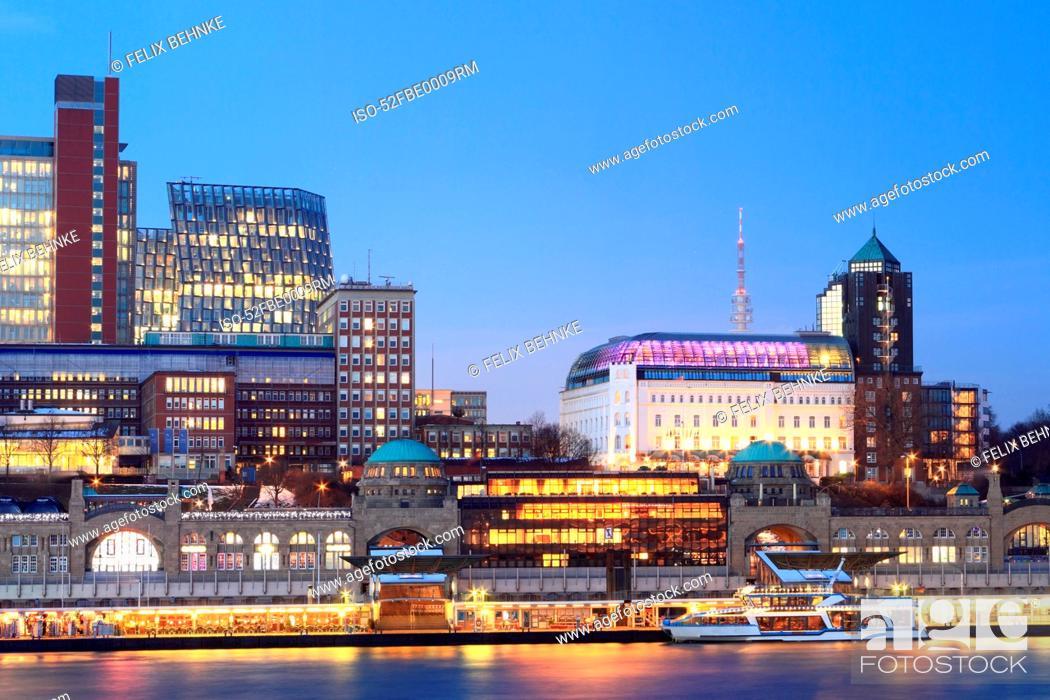 Stock Photo: Urban waterfront lit up at night.