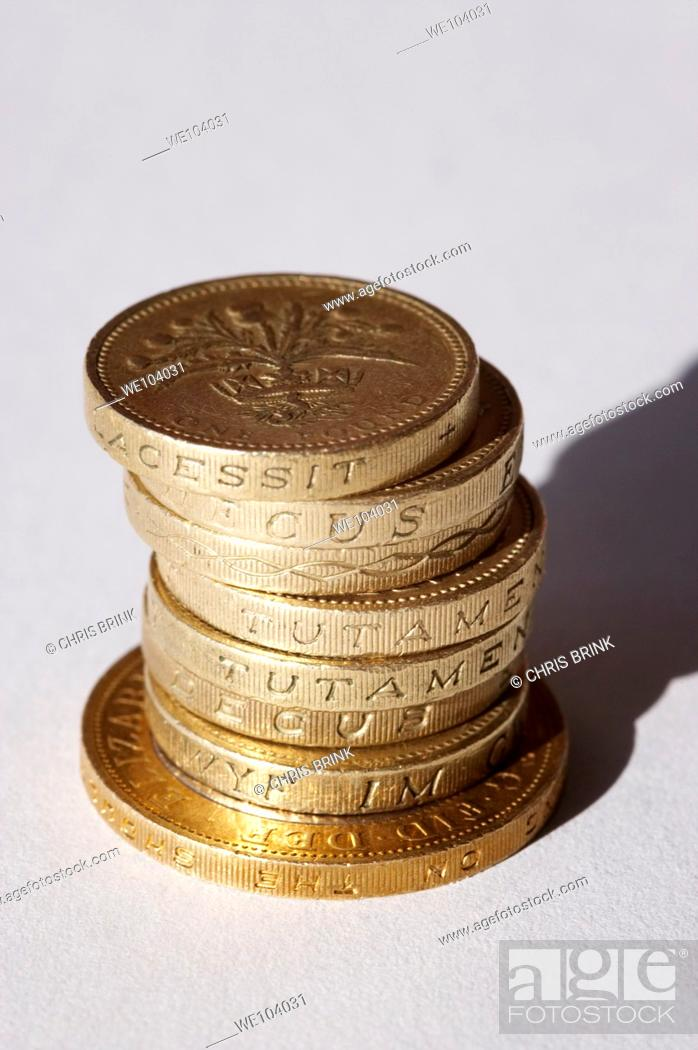Stock Photo: Pile of 7 English one pound coins, with one two pond coin.