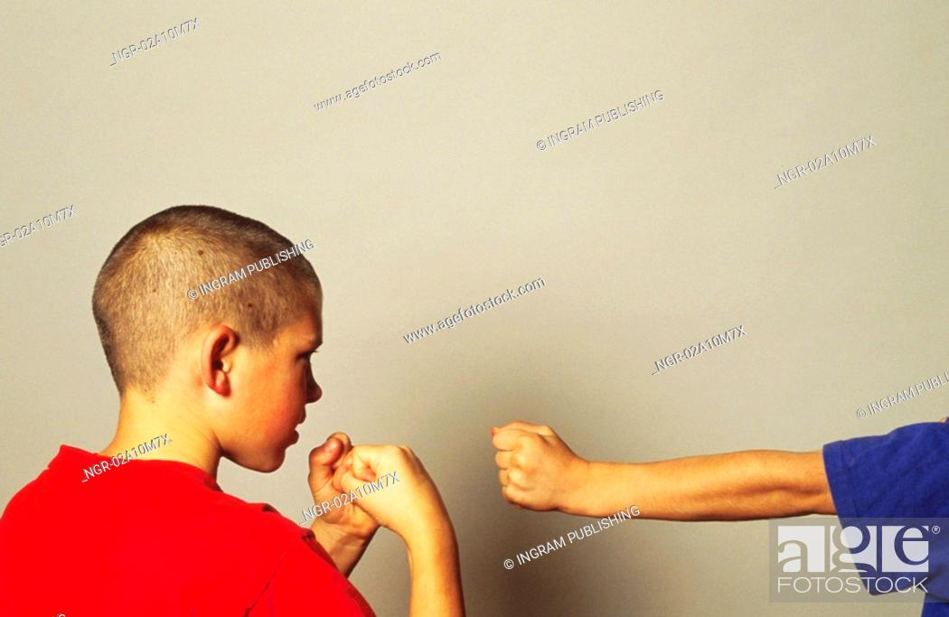 Stock Photo: Two Boys Fighting.