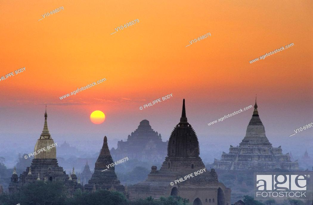 Stock Photo: Sunset on the site of Bagan, Myanmar.