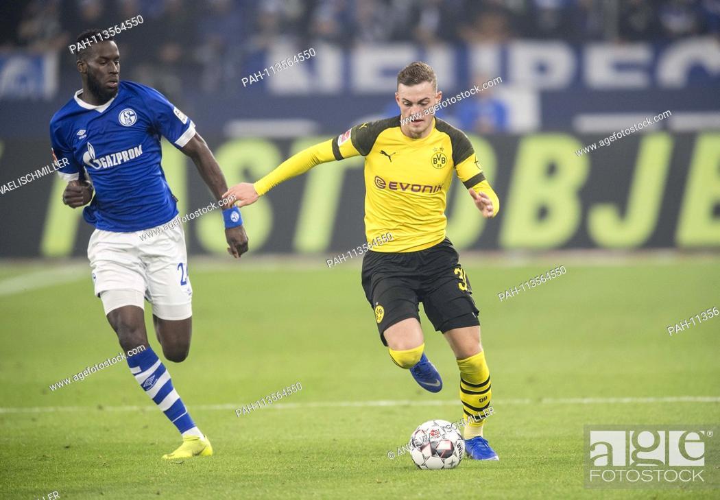Stock Photo: Jacob BRUUN LARSEN r. (DO) in action versus Salif SANE (GE), duels, Soccer 1.Bundesliga, 14.matchday, FC Schalke 04 (GE) - Borussia Dortmund (DO) 1: 2, on 08.