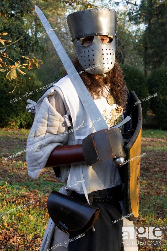 Mercenary knight with great helm, sword and shield, 13th