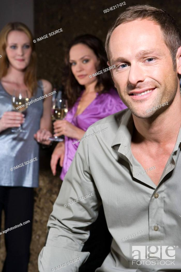 Stock Photo: Women looking at an attractive man.