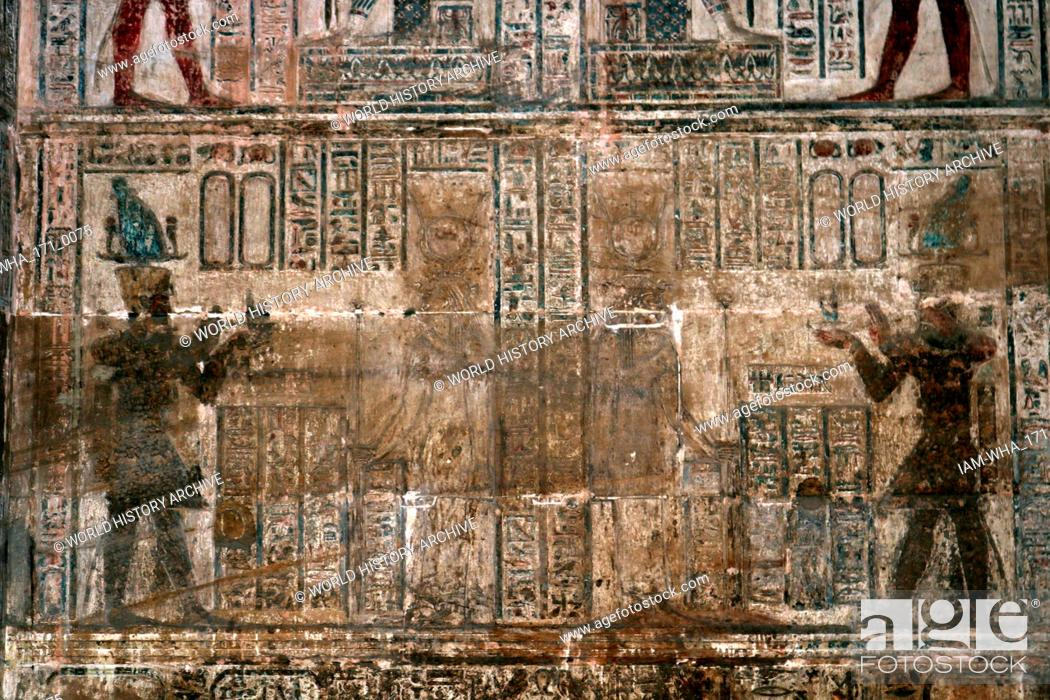 Stock Photo: Painted wall decoration, at Temple of Hathor, Dendera, Egypt. Depicting a king making offerings to a goddess. The Hathor temple (Temple of Tentyra) has been.