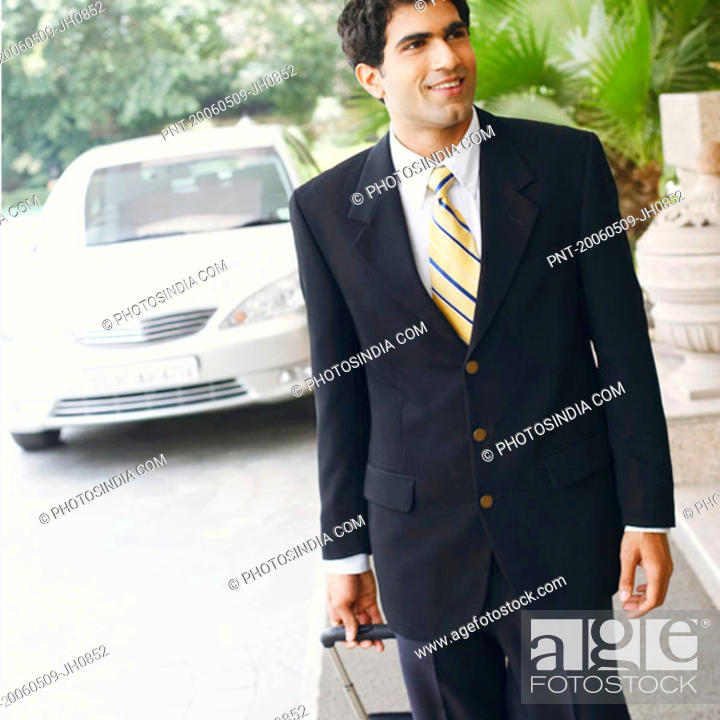 Stock Photo: Close-up of a businessman walking with a suitcase.