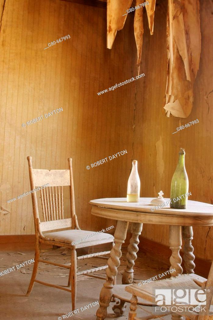 Stock Photo: Bottles on dining room table of Bodie residence, California, USA.