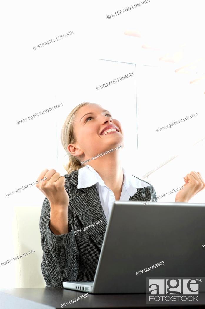 Stock Photo: Attractive young business woman receiving good news while working on her laptop.