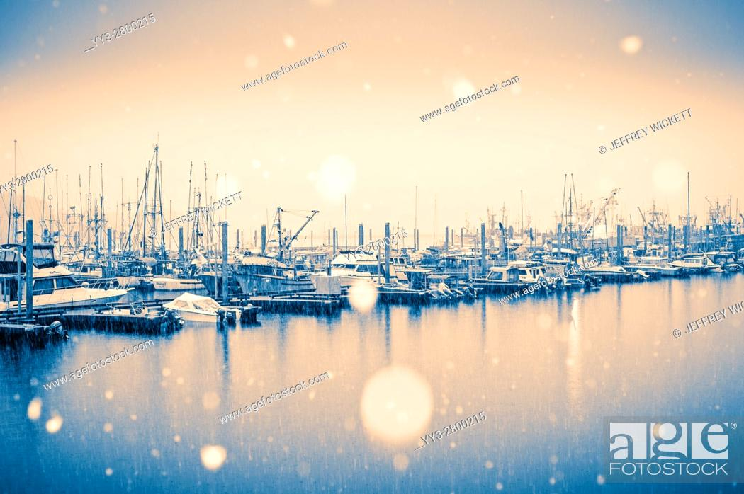 Stock Photo: Big snowflakes falling over Thomsen Harbor in Sitka, Alaska, USA.