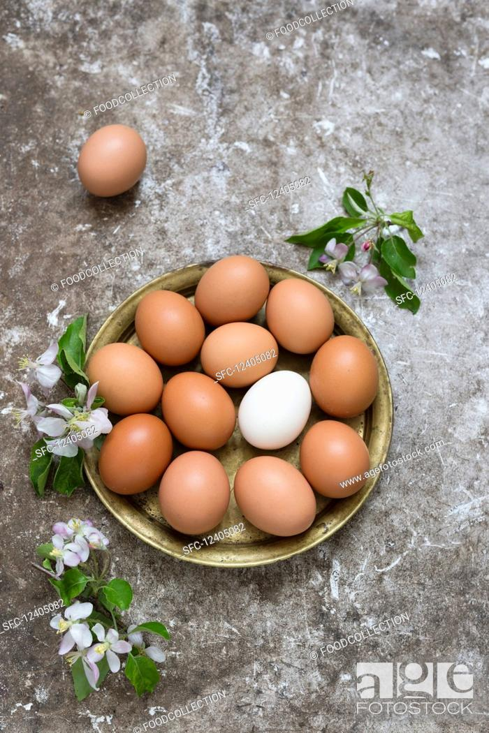 Stock Photo: Fresh eggs in a brass bowl.