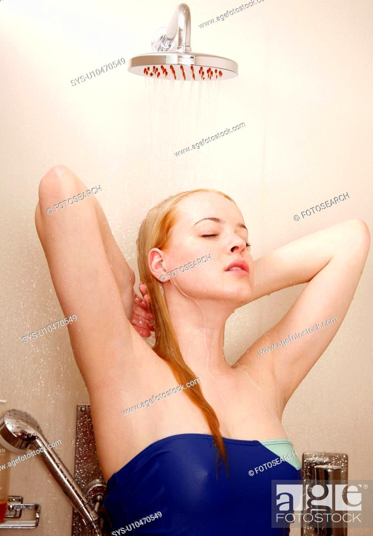 Stock Photo: Woman taking a shower at the gym.