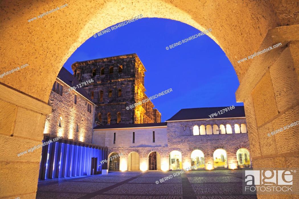 Stock Photo: Porta Nigra with archway, illuminated at night, Trier, Germany.
