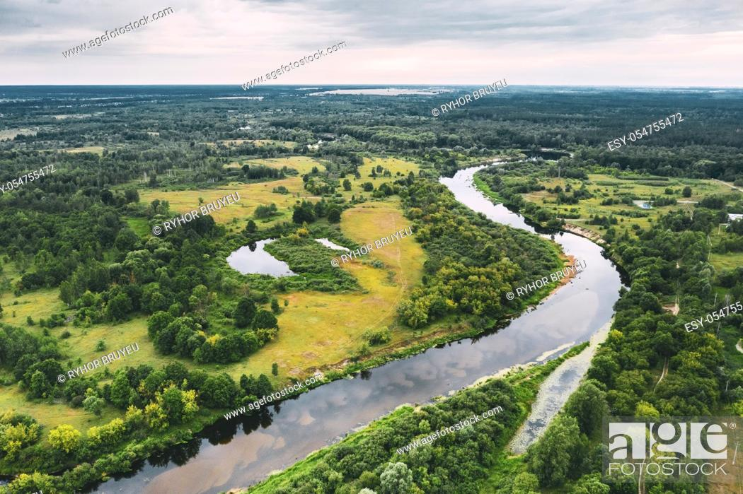 Stock Photo: Aerial View Green Meadow, Forest And River Landscape. Top View Of Beautiful European Nature From High Attitude In Summer Season. Drone View.
