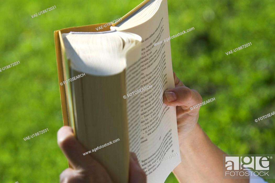 Stock Photo: Book, Close-Up, Day, Focus On Foreground, Holding.