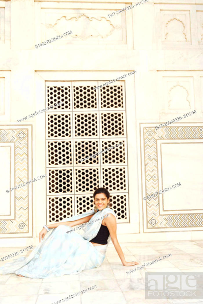 Stock Photo: Side profile of a young woman sitting in a mausoleum, Taj Mahal, Agra, Uttar Pradesh, India.