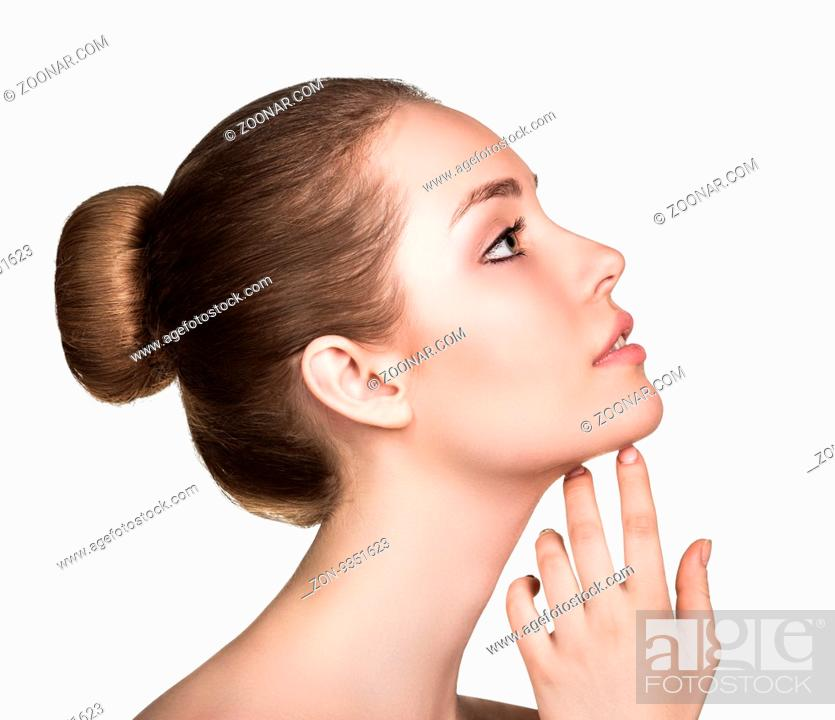Imagen: Beautiful woman cares for the skin- posing at studio isolated on white.