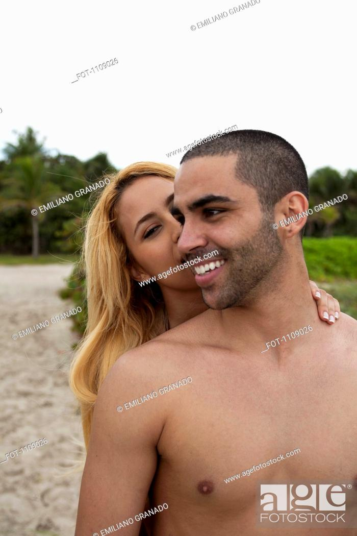 Stock Photo: A flirtatious young couple at the beach.