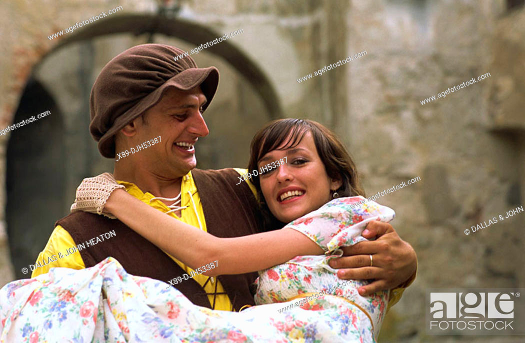 Stock Photo: Romania, Transylvania, Sighisoara, Drummer with Girl in Folk Costume MR53-01, 04.