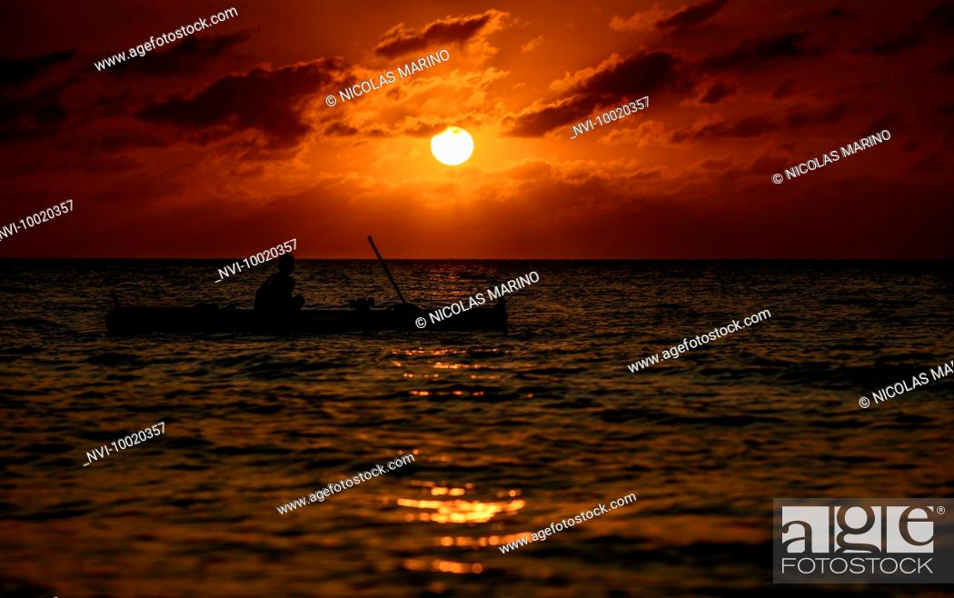 Stock Photo: Fishermen at sunset off the coast of Santa village, North Luzon, Philippines.