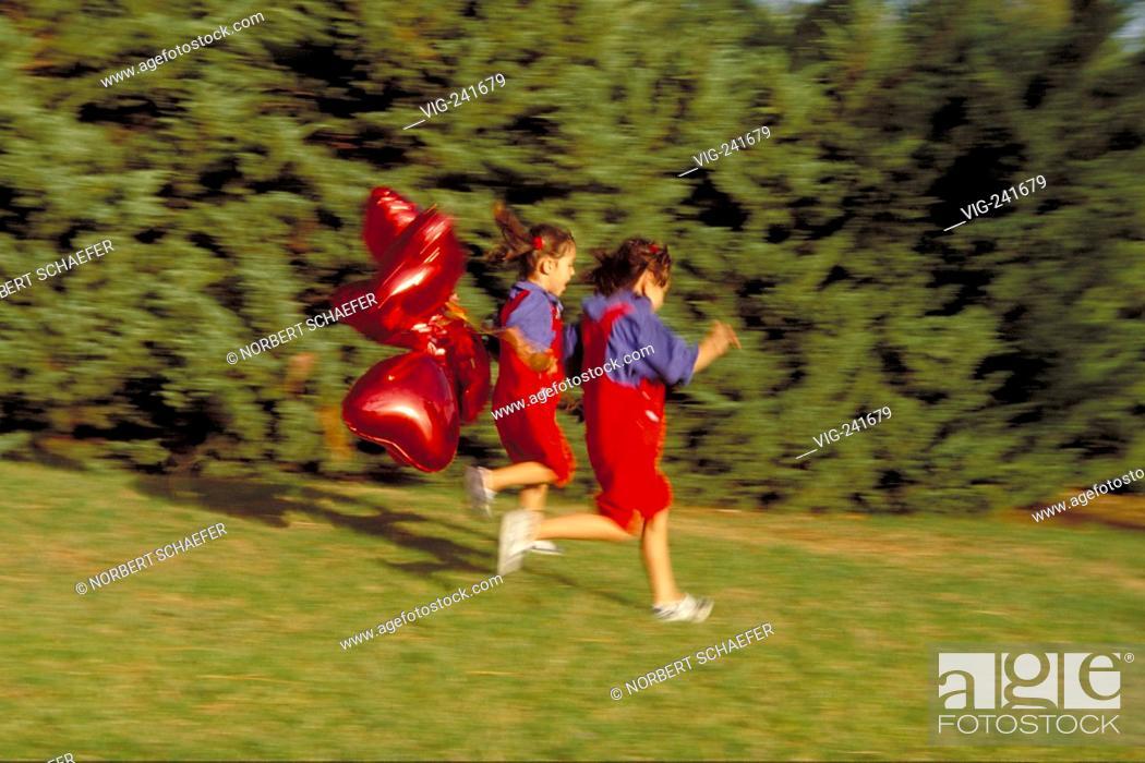 park-scene, full-figure, 2 twin-girls, 6 years old, wearing
