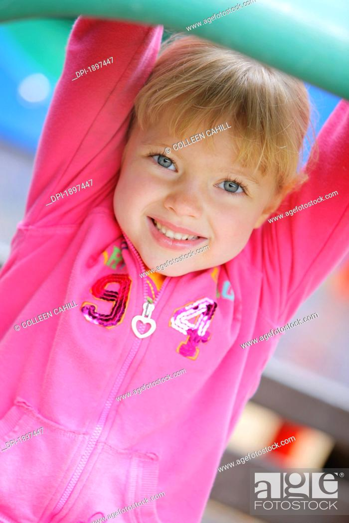 Stock Photo: portrait of a girl at the playground, troutdale, oregon, united states of america.