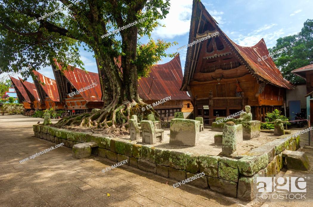 Stock Photo: Stone chairs of Ambarita and traditional Batak roof houses, Samosir Island, Lake Toba.