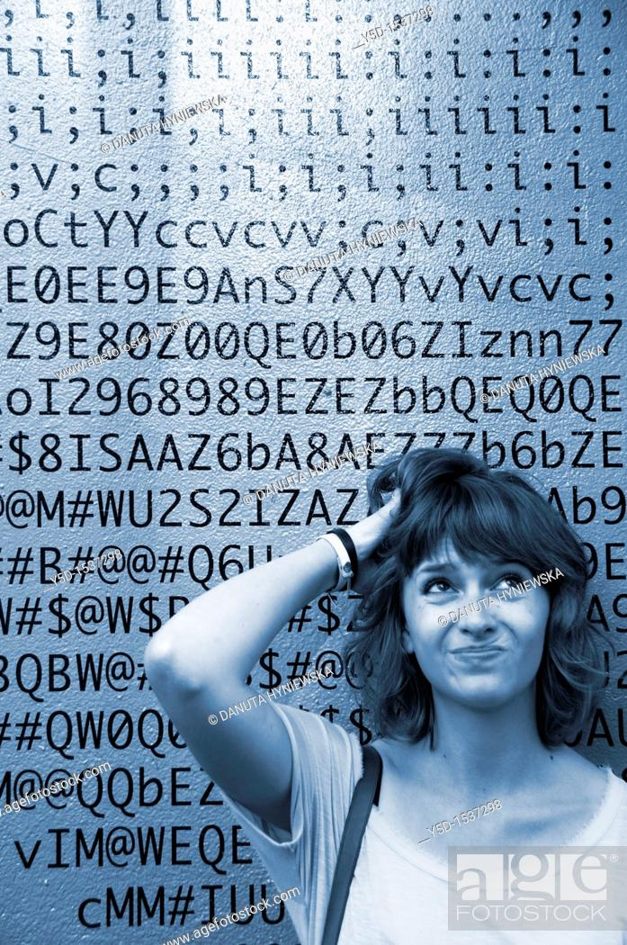 Stock Photo: A face of young woman in front of numbers, letters, symbols, background is a painted wall of one of the buildings in Geneva, Switzerland.