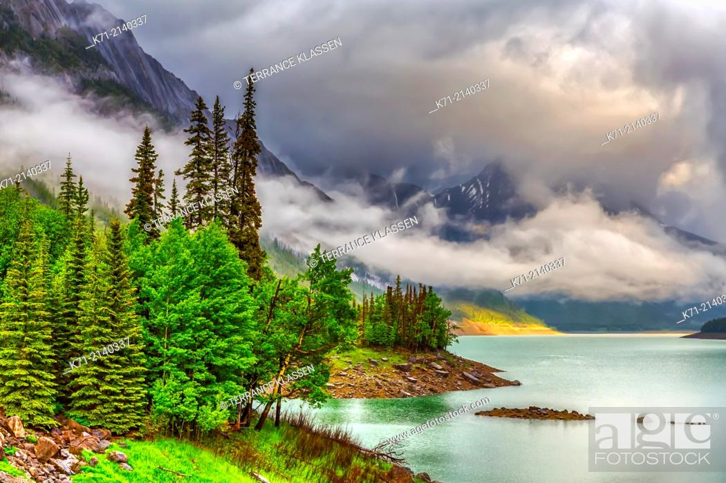 Stock Photo: Low hanging clouds on Medicine Lake in Jasper National Park, Alberta, Canada.