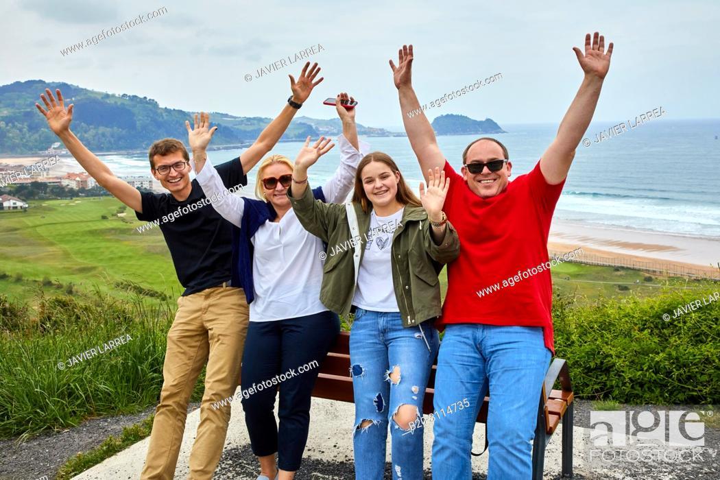 Stock Photo: Tour guide with group, Tour along the coast of the Basque Country, Zarautz, Gipuzkoa, Basque Country, Spain, Europe.