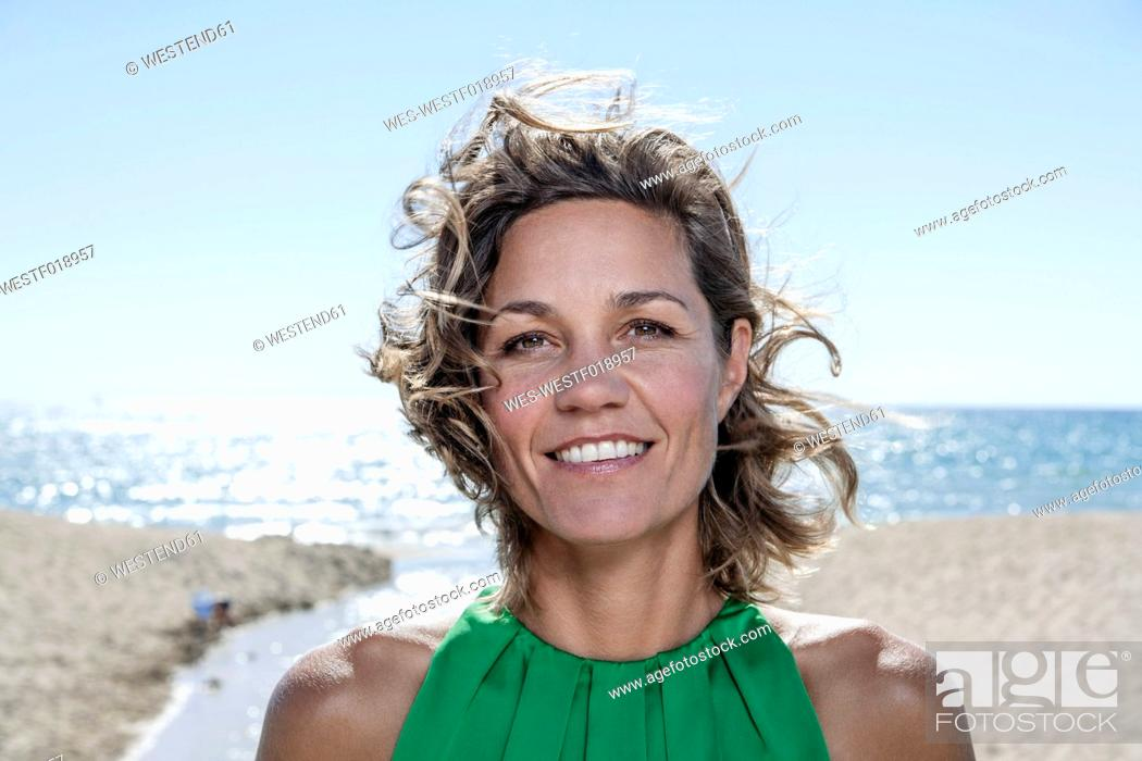 Stock Photo: Spain, Mid adult woman smiling, portrait.