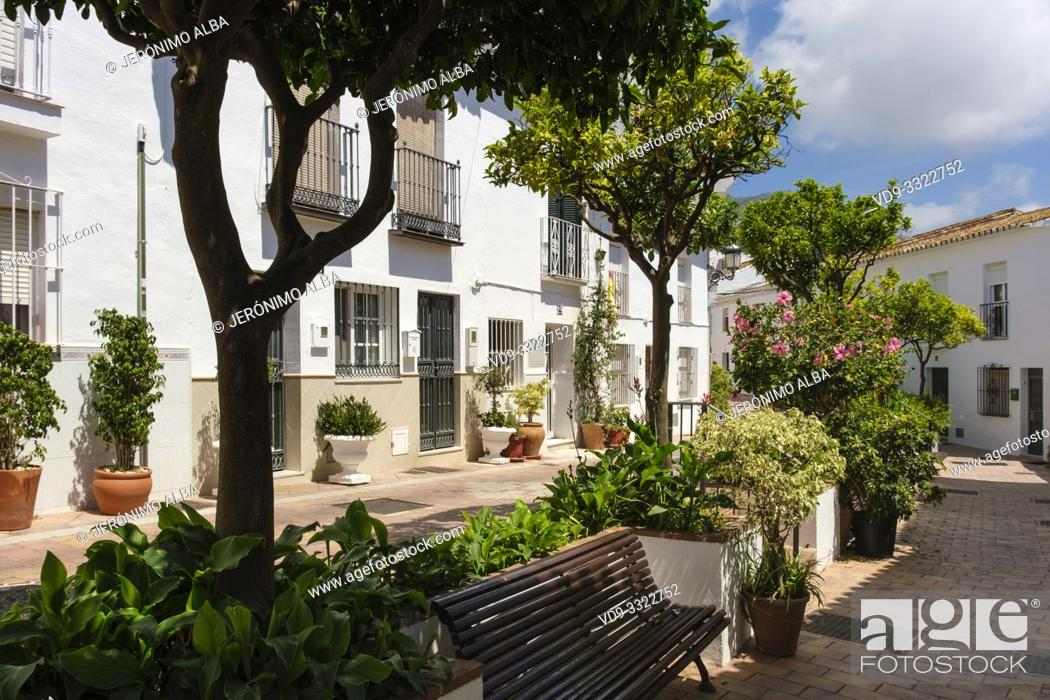 Stock Photo: Typical street with flowers in the white village of Benalmadena Pueblo. Malaga province, Costa del Sol. Andalusia, Spain Europe.