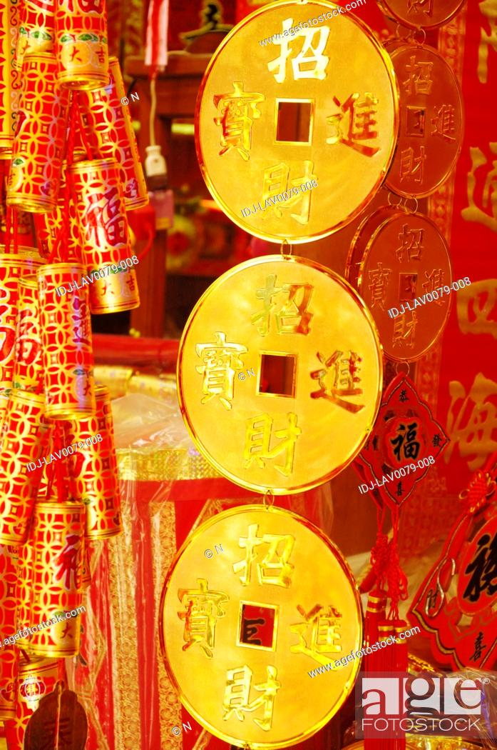 Stock Photo: Chinese coins and Chinese firecrackers at a market stall, Dihua Street, Taipei, Taiwan.