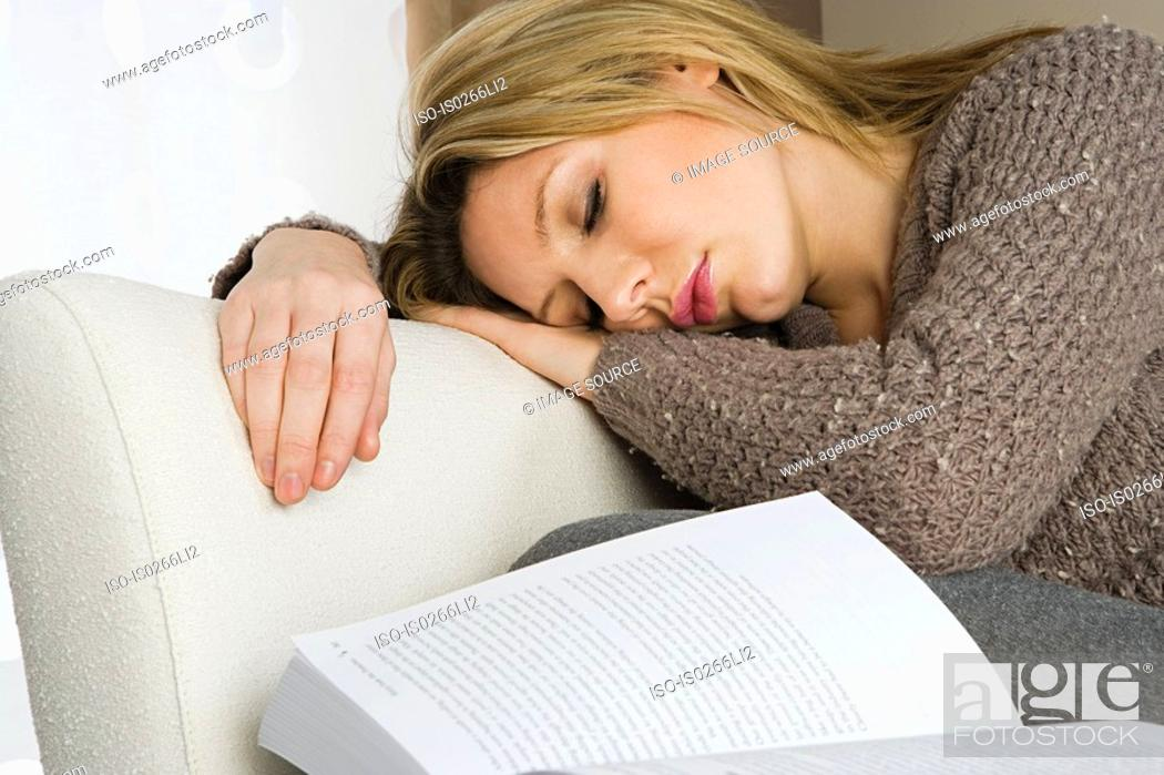 Stock Photo: Woman sleeping with book.
